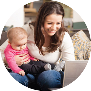 Picture of child with mother using childcare software online enrollment features